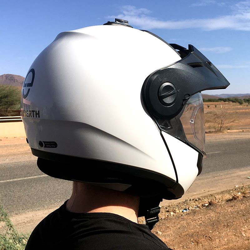 The main shell of the E1 is the same as Schuberth's C3 Pro, but the flip-up chinbar is revised and the peak is all-new