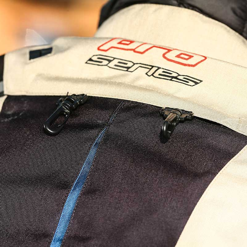 Hooks and pocket at the upper back accommodate an optional extra water bladder for drinking while riding