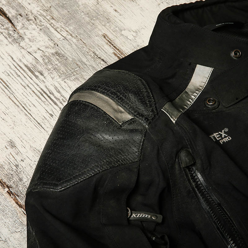 Heavy-duty textile with leather overlays in crucial areas delivers the flexibility of textile and the protection of leather