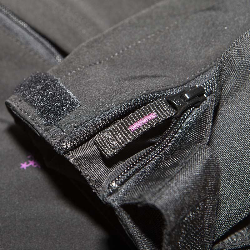 Velcro and zips help the cuffs fit over or under gloves