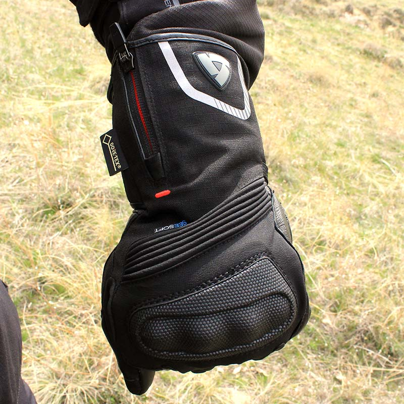 Twin cuff means the outer section can sit outside a jacket sleeve without rain running inside