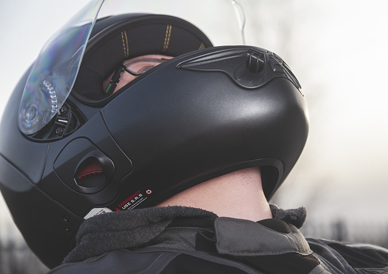 Wot, no chinstrap? No need, the helmet's hinged opening means it can secure under the rider's chin
