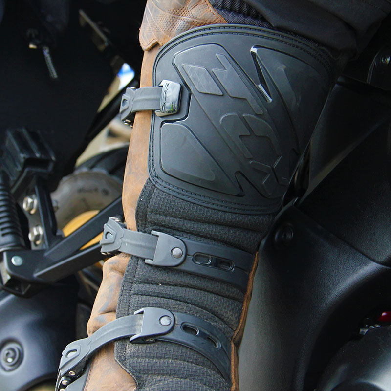 Hard plastic shin armour is part of a robust protective offering