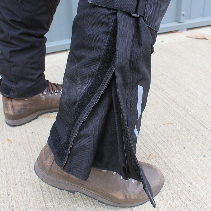 The bottom of the legs can be opened out to make getting boots underneath easier