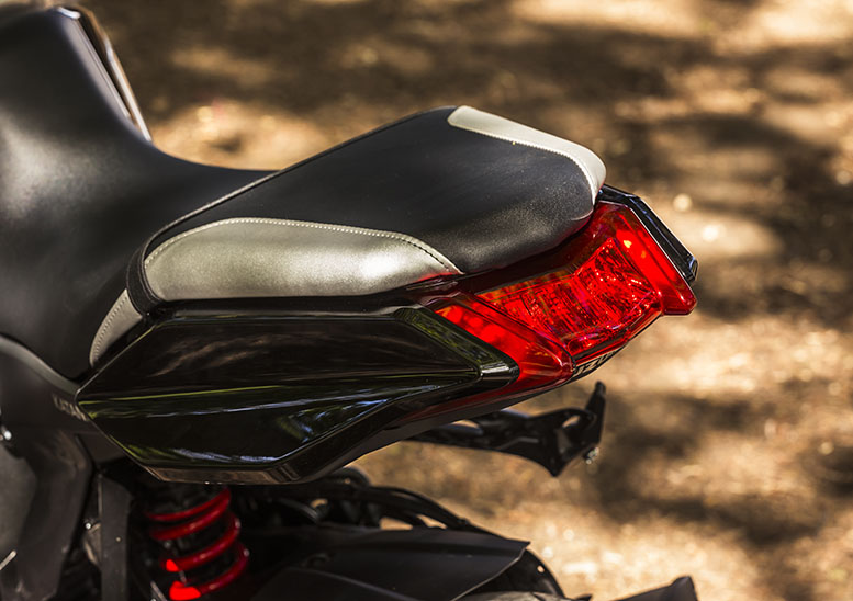 Wraparound numberplate hanger allows a clean look around the rear of the seat