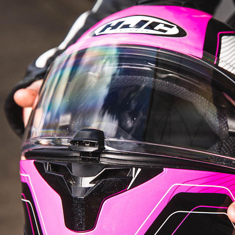 Central visor tab is for lifting, locking or holding it slightly open to allow in some air