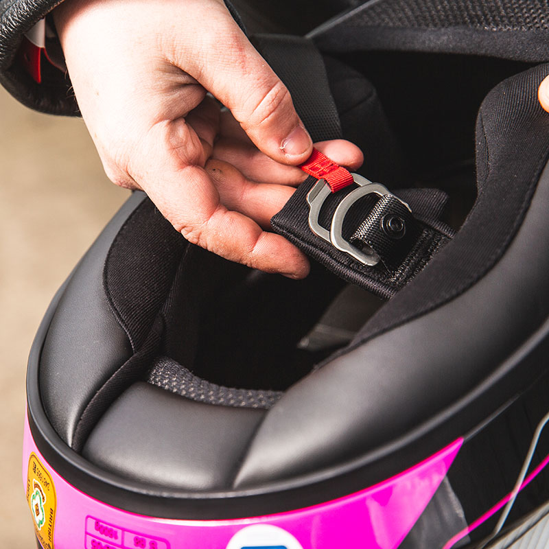 UK riders get a D-ring strap fastener - it's a buckle in the States and Europe